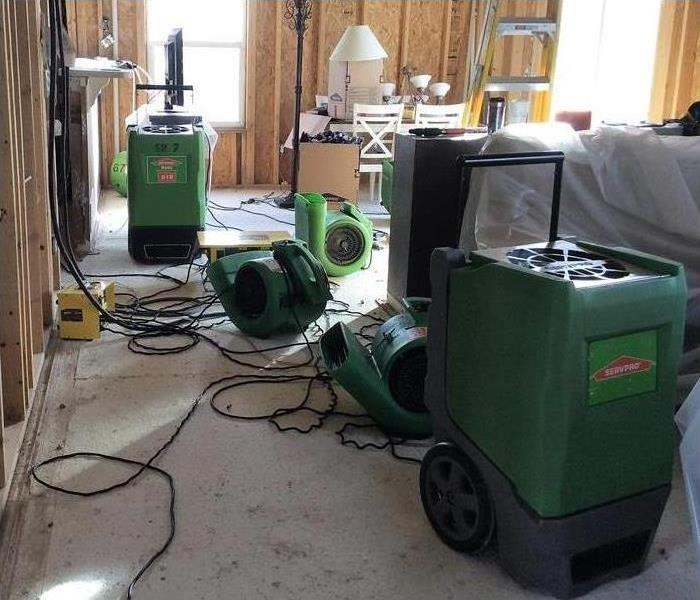 SERVPRO drying equipment pointed at ceiling